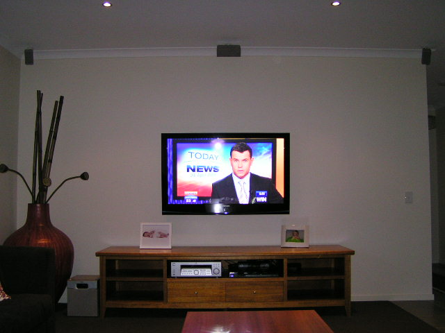 Wall mounted TV with speakers